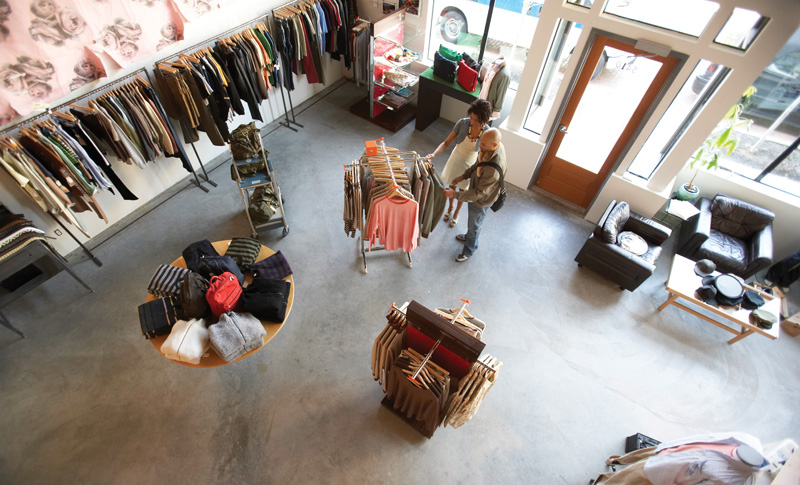 Man and woman looking at clothing in retail store, elevated view